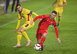 WREXHAM, WALES - Tuesday, November 17, 2015: Wales' Wesley Burns in action against Romania's captain captain Deian Boldor during the UEFA Under-21 Championship Qualifying Group 5 match at the Racecourse Ground. (Pic by David Rawcliffe/Propaganda)