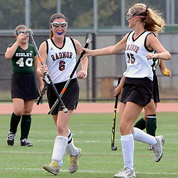 Radnor's Lexi Kenneally (6) and Lauren Hemcher (15) click sticks celebrating the win over Ridley following the final buzzer during the Radnor at Ridley field hockey game, Thursday afternoon September 11, 2014. (Times staff / TOM KELLY IV)