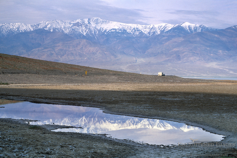 Storm clouds over Panamint Mountains and flood waters at sunrise, near Badwater, Death Valley, California