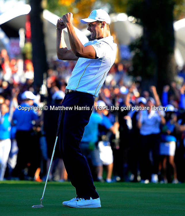 Martin KAYMER (GER) secures point to retain Ryder Cup for Europe at 18th green during final day Singles,Ryder Cup Matches,Medinah CC,<br /> Medinah,Illinois,USA.