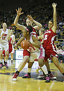 February 16 2011: Iowa Hawkeyes guard Kachine Alexander (21) tries to avoid Wisconsin Badgers forward Lin Zastrow (33) and Wisconsin Badgers guard Taylor Wurtz (2) during the first half of an NCAA women's college basketball game at Carver-Hawkeye Arena in Iowa City, Iowa on February 16, 2011. Iowa defeated Wisconsin 59-44.