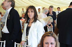 OLIVIA HARRISON at a luncheon hosted by Cartier for their sponsorship of the Style et Luxe part of the Goodwood Festival of Speed at Goodwood House, West Sussex on 4th July 2010.