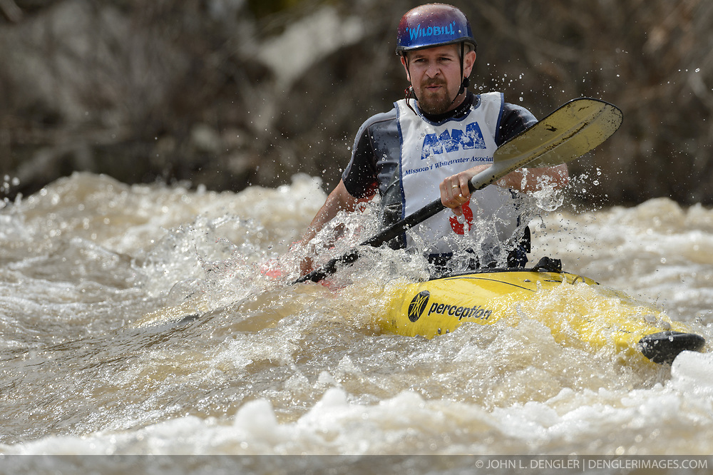 Bill Miles of Cuba, Mo. races in the K1 Men's Expert class on the slalom course of the 45th Annual Missouri Whitewater Championships. Miles placed third in the class and first in the C1 Men's Plastic class. The Missouri Whitewater Championships, held on the St. Francis River at the Millstream Gardens Conservation Area, is the oldest regional whitewater slalom race in the United States.  Heavy rain in the days prior to the competition sent water levels on the St. Francis River to some of the highest heights that the race has ever been run. Only expert classes were run on the flood level race course.