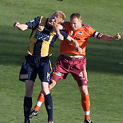 Matt Simon (left) and Craig Moore in action during the Central Coast Mariners V Brisbane Roar A-League match at Bluetongue Stadium, Gosford, Australia, 19 December 2009. Photo Tim Clayton