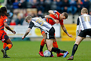 Notts County forward Jonathan Stead (30) is tackled by Wycombe Wanderers defender Adam El-Abd (6)  during the EFL Sky Bet League 2 match between Notts County and Wycombe Wanderers at Meadow Lane, Nottingham, England on 30 March 2018. Picture by Simon Davies.