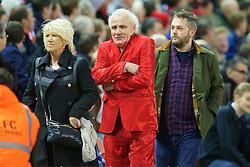 LIVERPOOL, ENGLAND - Boxing Day, Saturday, December 26, 2015: A Liverpool supporter dressed in a shiny red suit during the Premier League match against Leicester City at Anfield. (Pic by David Rawcliffe/Propaganda)