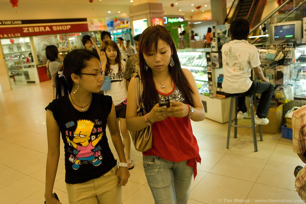 Sex trafficking survivors Srey Neth, left, and Tieng, right, at the Sorya Mall in downtown Phnom Penh. Both teenage women were cared for by the victim aftercare NGO Transitions Global.