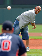 Pittsburgh Steelers wide receiver Hines Ward, right, throws out the first pitch to Atlanta Braves third baseman Chipper Jones before the start of their spring training baseball game against the Pittsburgh Pirates in Lake Buena Vista, Florida.