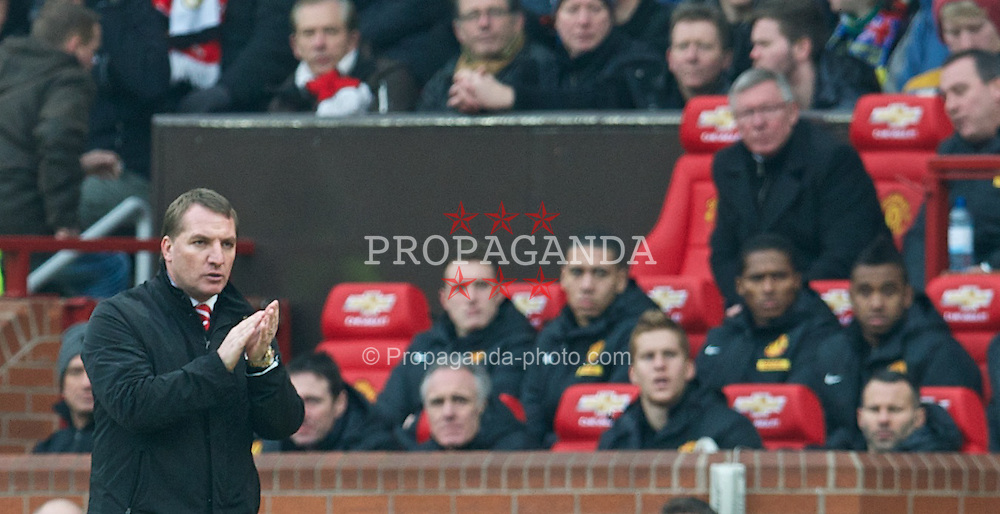 MANCHESTER, ENGLAND - Sunday, January 13, 2013: Liverpool's manager Brendan Rodgers and Manchester United's manager Alex Ferguson during the Premiership match at Old Trafford. (Pic by David Rawcliffe/Propaganda)
