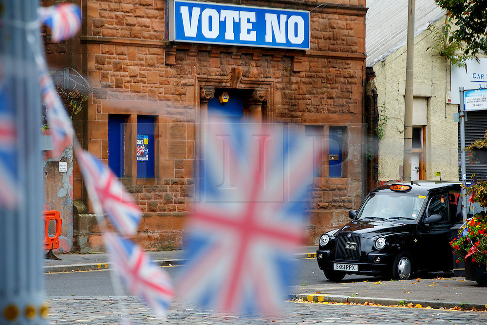 © Licensed to London News Pictures. 18/09/2014. Glasgow, UK. Union jack flags are seen in Bridgeton, a unionist area of Glasgow, whilst  people of Scotland going to polling stations to vote on the Scottish independence referendum on Thursday, 18 September 2014. Photo credit : Tolga Akmen/LNP