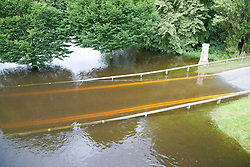 Road bridge over river Thames partially submerged under water after torrential rain caused flooding in Oxford and the Thames Valley area; July 2007,