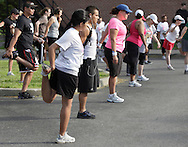 Middletown, New York - Runners stretch before competing in the 15th annual Ruthie Dino Marshall 5K Run and Fun Walk hosted by the Middletown YMCA  on Sunday, June 5,  2011.