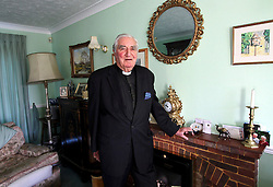 "© Licensed to London News Pictures. 01/02/2012. Uckfield, UK. BILL PETERS at home. Canon Bill Peters of Uckfield, the only chaplain who served in the Second World War still working, is celebrating his 70th year in the church as he approaches his 93rd birthday this year. It has been 67 years since he signed up with the Royal Army Chaplains Department. Canon Peters, who lives in Uckfield is a widower of 10 years and a grand-father of two, He claims he still has a lot left to achieve and said: ""If anybody wants to get married, and the parish is happy, then I do them. I do more weddings than funerals. I have been a priest for 70 years this year and I have spent all that time in Sussex, except when I was in the army and canon of a cathedral."" Photo credit : Ron Hill/LNP NOTE TO EDITORS - WORDS AVAILABLE HERE: http://tinyurl.com/73zbhmu"