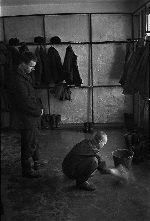 Russian young prisoner clean up the cloakroom at the colony for prisoner's children in Siberian town Leninsk-Kuznetsky, Russia, 15 December 1999.