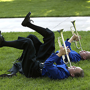 Mallory Richardson, 14, (bottom) and Morgan Achterhoff, 13,  members of the MOC-Floyd Valley Middle School band tune up their trumpets for the last of  the six parades that they marched in during the annual Tulip Festival in Orange City, Ia.  The festival is held on the third weekend in May.