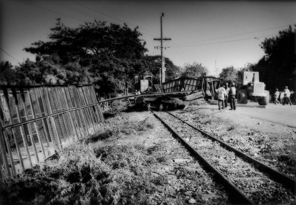 Result of a collision of two trains which carry sugar cane to the sugar mill in Barahona which are not fitted with radio transmitters.  Police suggested that the accident could have been avoided had the drivers of the two trains could have communicated with radios, Dominican Republic.