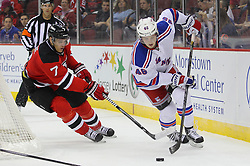 Sep 16, 2013; Newark, NJ, USA; New York Rangers right wing Danny Kristo (46) skates with the puck while being defended by New Jersey Devils defenseman Mark Fayne (7) during the first period at Prudential Center.