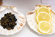 Two of the ingredients - coffee beans and lemon - used to make a queimada punch. Rooted in Celtic tradition, the flaming queimada drink of Galicia is believed to ward off evil spirits. Santiago de Compostela, Galicia, Spain.