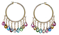 garnet teardrop earrings on a hoop setting