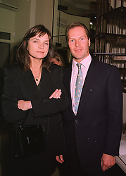 MR & MRS JOHN LORIMER, friends of the Duke of York, at a party in London on 29th April 1998.MHG 56