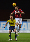 Northampton Town Forward Marc Richards beats Oxford United Defender Johnny Mullins to the ball during the Sky Bet League 2 match between Oxford United and Northampton Town at the Kassam Stadium, Oxford, England on 16 February 2016. Photo by Adam Rivers.