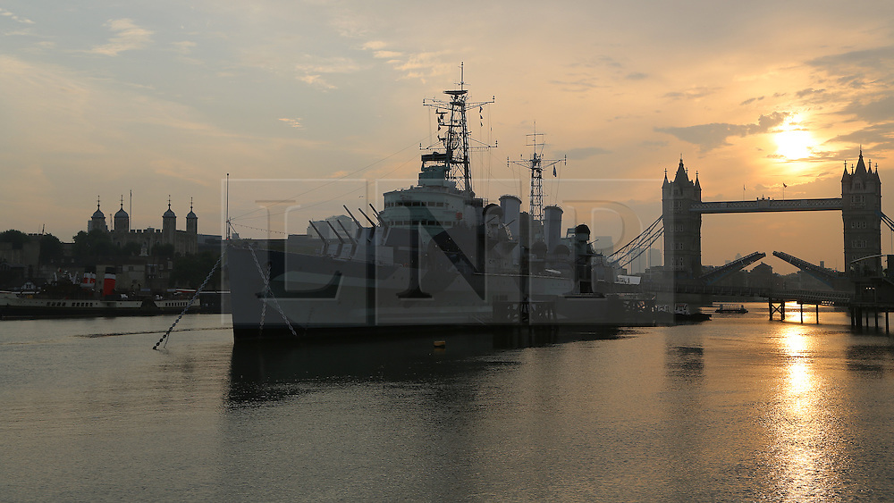 © Licensed to London News Pictures. 28/09/2013. Iconic Tower Bridge against an Autumn sunrise. Seen here with HMS Belfast in the foreground and the historic paddle steamer Waverley at Tower Bridge pier. Credit : Rob Powell/LNP