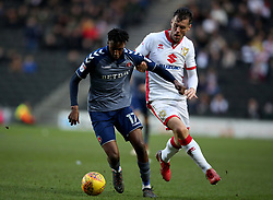 Charlton Athletic's Joe Aribo and MK Dons Eliott Ward during the Sky Bet League One
