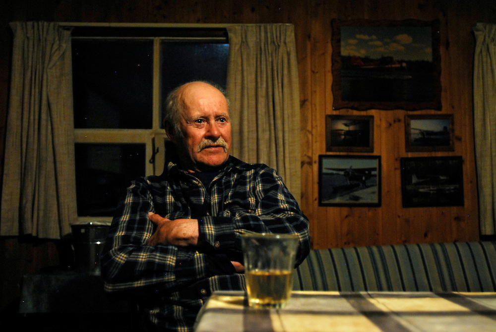 "URANIUM CITY, SK - 11/10/08 - Resident since 1986, Rod Atton in his home in rural Uranium City, Saskatchewan. At 78-years-old, the former commercial pilot has no intentions of leaving anytime soon.  ""As soon as I saw this country, I knew I wanted to live here."""