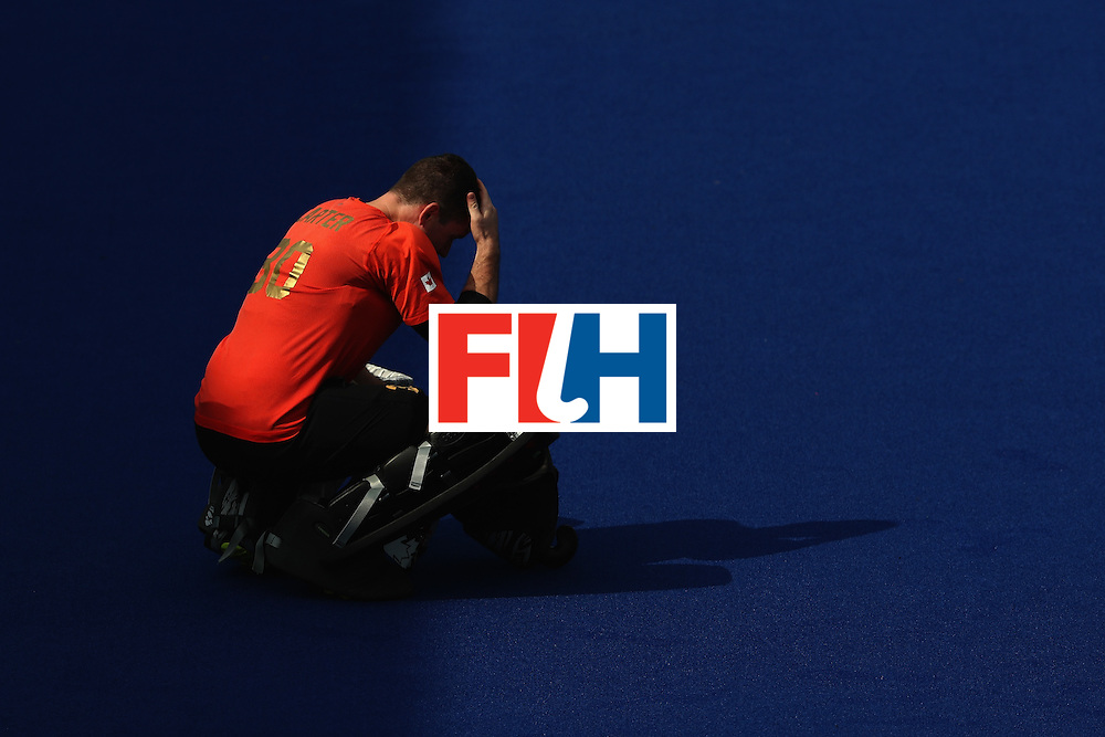 RIO DE JANEIRO, BRAZIL - AUGUST 08:  David Carter #30 of Canada kneels in goal against Argentina during a Men's Pool B match on Day 3 of the Rio 2016 Olympic Games at the Olympic Hockey Centre on August 8, 2016 in Rio de Janeiro, Brazil.  (Photo by Sean M. Haffey/Getty Images)