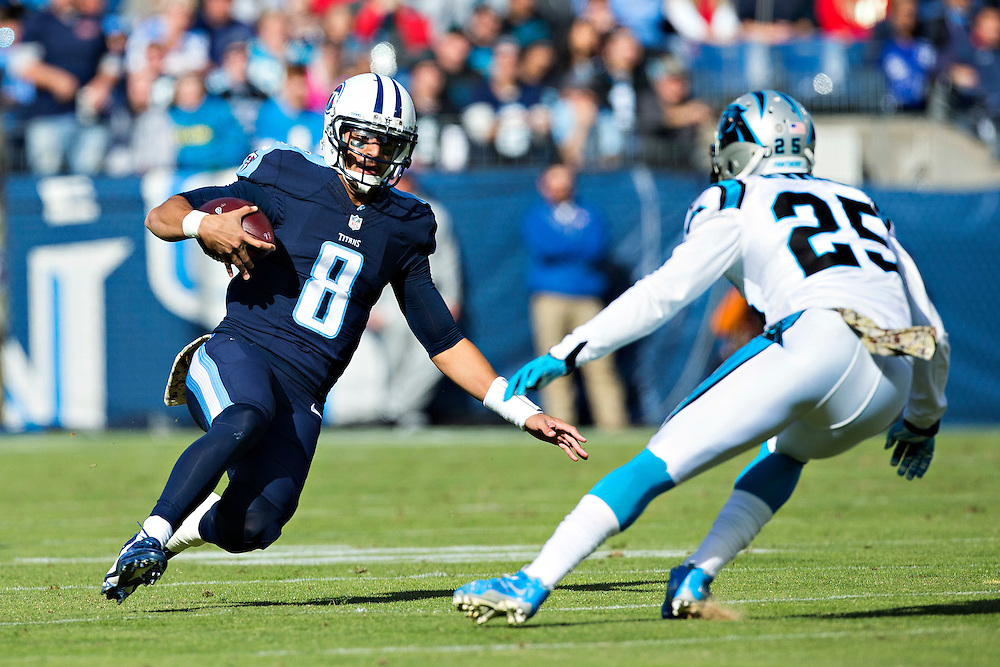 NASHVILLE, TN - NOVEMBER 15:  Marcus Mariota #8 of the Tennessee Titans slides down in front of Bene Benwikere #25 of the Carolina Panthers at Nissan Stadium on November 15, 2015 in Nashville, Tennessee.  (Photo by Wesley Hitt/Getty Images) *** Local Caption *** Marcus Mariota; Bene Benwikere