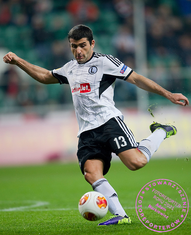 Legia's Vladimer Dvalishvili shoots on goal during the UEFA Europa League Group J football match between Legia Warsaw and Trabzonspor AS at Pepsi Arena Stadium in Warsaw on November 07, 2013.<br /> <br /> Poland, Warsaw, November 07, 2013<br /> <br /> Picture also available in RAW (NEF) or TIFF format on special request.<br /> <br /> For editorial use only. Any commercial or promotional use requires permission.<br /> <br /> Mandatory credit:<br /> Photo by &copy; Adam Nurkiewicz / Mediasport