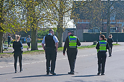 ©Licensed to London News Pictures 26/03/2020<br /> Greenwich, UK. Police in Greenwich Park. People get out and about in Greenwich Park, Greenwich, London this afternoon as they make the most of their permitted one a day exercise out of the house from Coronavirus Lockdown. The Prime Minister Boris Johnson has asked people to stay at home to help in the fight against Covid-19. Photo credit: LNP
