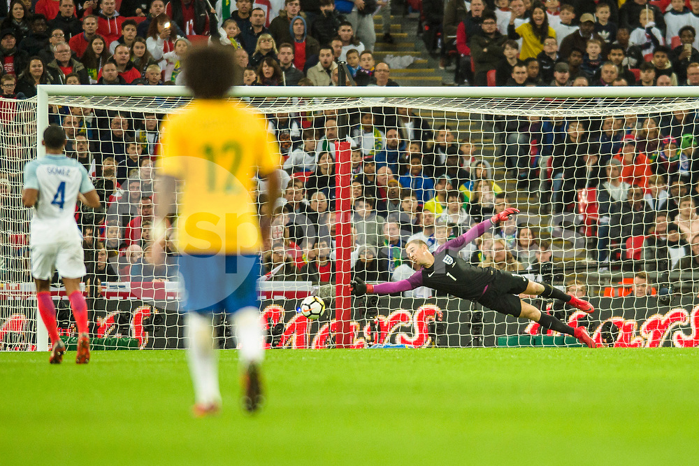 Joe Hart of England stretches but can't reach a shot that grazes the post during the international friendly match between England and Brazil at Wembley Stadium, London, England on 14 November 2017. Photo by Darren Musgrove.
