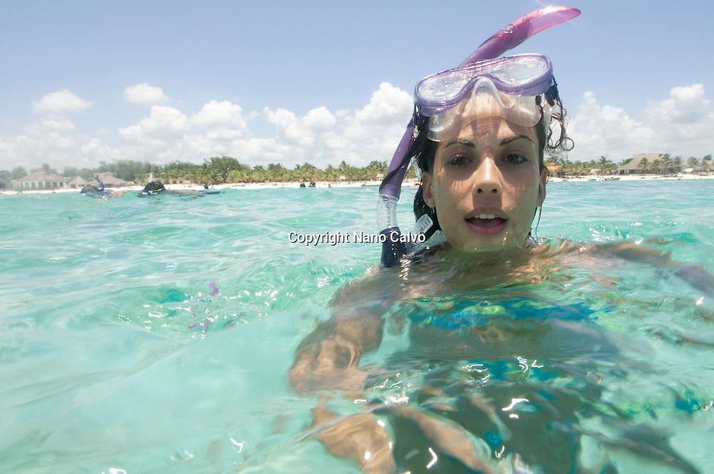 MR Attractive girl snorkelling in Akumal, Yucatan Peninsula, Mexico