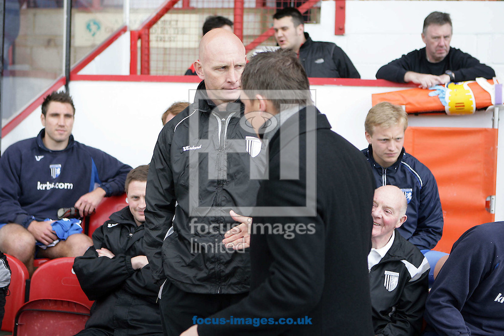 London - Saturday, March 28th, 2009: Gillingham manager Paul Stimson (L) refuses to shake Brentford manager Andy Scott's hand due to Stimson blaming Scott's involvement in the F.A.' s decision to ban Gillingham defender Garry Richards three game ban after the two sides met in December 2008 during the Coca Cola League Two match at Griffin Park, London. (Pic by Mark Chapman/Focus Images)