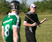 Neville Morgan of Rochester explains a drill to players during a practice of the Rochester Hurling Club in Henrietta on Wednesday, June 3, 2015.