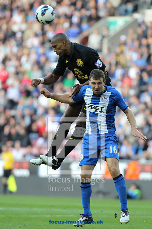 Picture by Michael Sedgwick/Focus Images Ltd +44 7900 363072.06/10/2012.James McArthur of Wigan Athletic and Sylvain Distin of Everton in action during the Barclays Premier League match at the DW Stadium, Wigan.