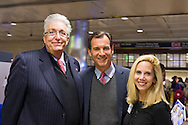 Manhattan, New York, U.S. 4th November 2013. L-R, Democrats HOWARD WEITZMAN, candidate to Nassau County Comptroller, TOM SUOZZI, candidate for Nassau County Executive, and LAURA GILLEN, running for Nassau County Clerk, pose for a group photo at their campaign stop at Penn Station, near end of 36 straight hours of barnstorming across Nassau County, leading up to the November 5 general election.