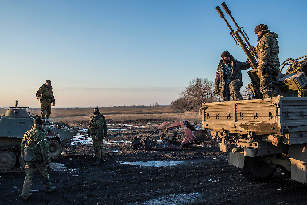 DEBALTSEVE, UKRAINE - FEBRUARY 20: A group of pro-Russian Cossack rebel fighters organize equipment, some of which was captured from the Ukrainian Army, on February 20, 2015 in Debaltseve, Ukraine. Ukrainian forces withdrew from the strategic and hard-fought town after being effectively surrounded by pro-Russian rebels, though fighting has caused widespread destruction. (Photo by Brendan Hoffman/Getty Images) *** Local Caption ***