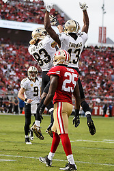 SANTA CLARA, CA - NOVEMBER 06: Wide receiver Michael Thomas #13 of the New Orleans Saints is congratulated by Willie Snead #83 after scoring a touchdown against the San Francisco 49ers during the first quarter at Levi's Stadium on November 6, 2016 in Santa Clara, California.  (Photo by Jason O. Watson/Getty Images) *** Local Caption *** Michael Thomas; Willie Snead