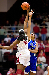 December 15, 2009; Stanford, CA, USA;  Duke Blue Devils center Krystal Thomas (34) and Stanford Cardinal forward Nnemkadi Ogwumike (30) fight for the opening tip off during the first half at Maples Pavilion.