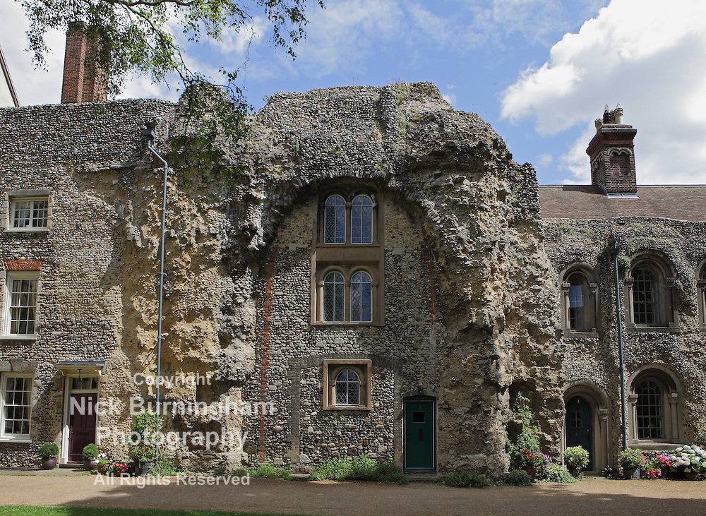 BURY ST EDMUNDS, SUFFOLK, UK - AUGUST 2, 2012: A house is built into the wall of the old abbey ruins on August 2, 2012. The 11th century Abbey  was once among the richest Benedictine monasteries in England.