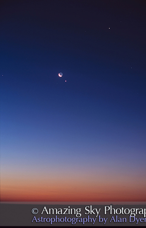 Venus-Moon conjunction, early morning sky, August 16, 2001..50mm lens at f/2.8.Fuji Provia 100F slide film, about 1 minute exposure, tracked..Moon near Venus, Jupiter above right.Taken from home in Alberta