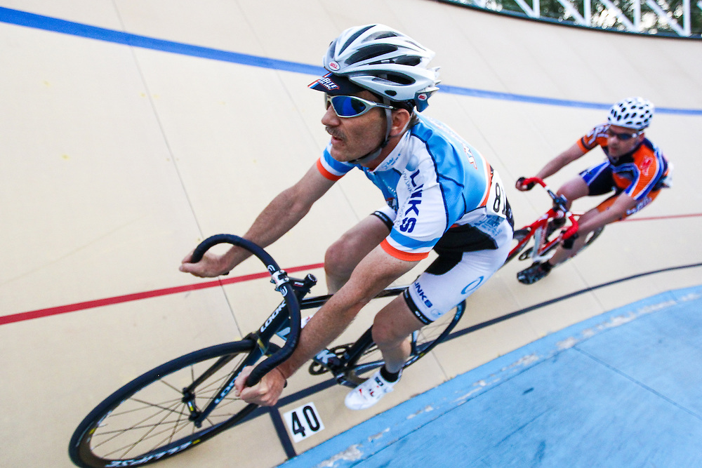 Bob Stafancin Jr. leads another rider through the turn during 2013 State Championship racing at the Cleveland (Ohio) velodrome.