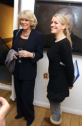 Left to right, HRH the DUCHESS OF CORNWALL and her daughter LAURA PARKER BOWLES at an exhibition of artist Jonathan Yeo's portrait paintings held at Eleven, 11 Eccleston Street, London SW1 on 16th February 2006.<br />