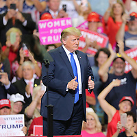 President Donald Trump makes way across the stage before he starts the rally for Senator Cindy Hyde Smith and the Mississippi Republican Party Tuesday night in Southaven.