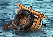 8/1994-Al Diaz/Miami Herald--In 1994 Cuban balseros turned the tiny fishing village of Cojimar into a major point of embarkation for thousands seeking a better life. Here, A Cuban rafter flips his raft off the coast of  Cojimar, Cuba during his desperate attempt to reach the U.S.