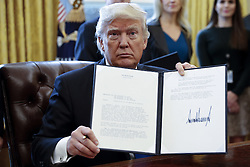 January 24, 2017 - Washington, District of Columbia, U.S. - US President DONALD TRUMP displays one of five executive orders he signed on Keystone and Dakota oil pipeline constuction in the oval office of the White House. (Credit Image: © Shawn Thew/CNP via ZUMA Wire)