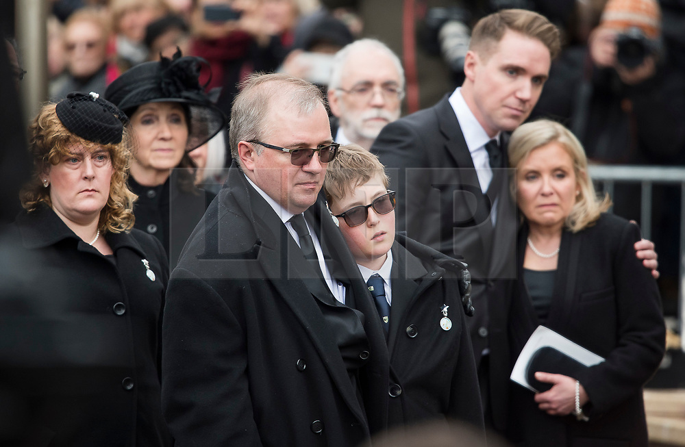 © Licensed to London News Pictures. 31/03/2018. Cambridge, UK. L TO R DAUGHTER IN LAW (Name unknown) JANE HAWKING (first wife) ROBERT HAWKING (SON) GRANDSON (Name unknown) TIMOTHY HAWKING (son) and LUCY HAWKING (Daughter) Family watch as at the coffin leaves the funeral of Stephen Hawking at Church of St Mary the Great in Cambridge, Cambridgeshire. Professor Hawking, who was famous for ground-breaking work on singularities and black hole mechanics, suffered from motor neurone disease from the age of 21. He died at his Cambridge home in the morning of 14 March 2018, at the age of 76. Photo credit: Ben Cawthra/LNP