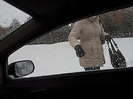 A woman gets picked up after work at the Univeristy of Windsor by her husband during a snow flurry, Windsor, Canada.